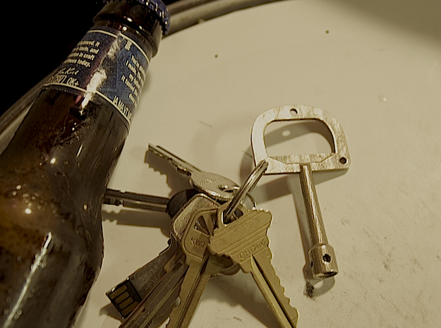 DruNKey v1.0 - A Drum Key Bottle Opener 3d printed This is a picture of the drum key bottle opener on a snare drum