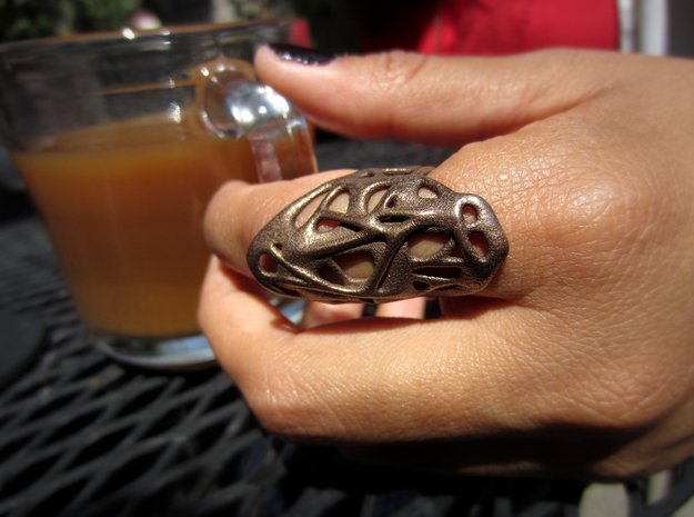 The Weave Ring 3d printed With Some Coffee (Bronze Steel)