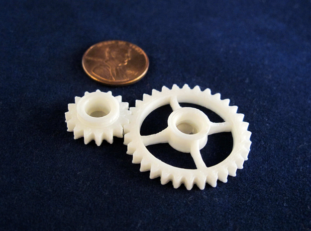 Semi-Formal Pocket Gear Train 3d printed White ABS, printed on a MakerBot Replicator.