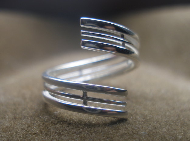 Bars & Wire Ring Size 12 3d printed Photo of the ring from the top, printed in sterling silver, this ring print is size 7.