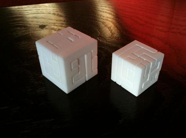 Switch Cube (3 cm) 3d printed 3cm cube on the left
