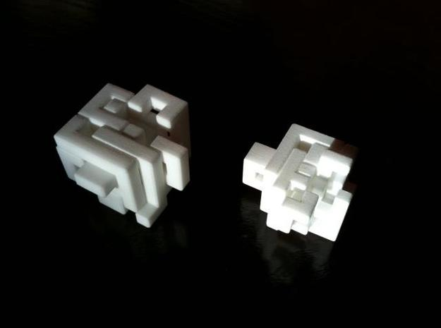 Switch Cube (3 cm) 3d printed 3 cm cube on the left - partially open