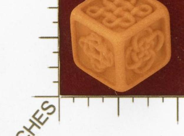 Celtic Die 3d printed Photo by Kevin Cook in an early, unpolished, orange strong and flexible.