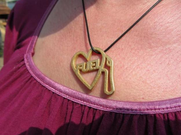 Love Pump Pendant 3d printed Gold has a lovely surface texture