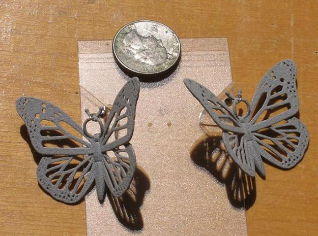 Monarch Earrings 3d printed Printed in Polished Aluminide with earring hooks included.