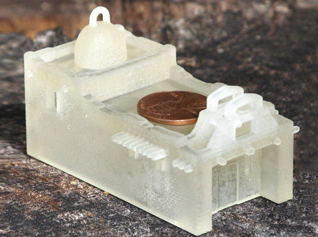Z Scale Adobe Mission 3d printed FUD print from the front with a penny for scale.