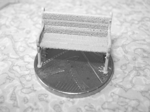 Victorian Ivy style 1:76 OO scale bench set 3d printed The two seat bench sat on a UK 1 pence coin