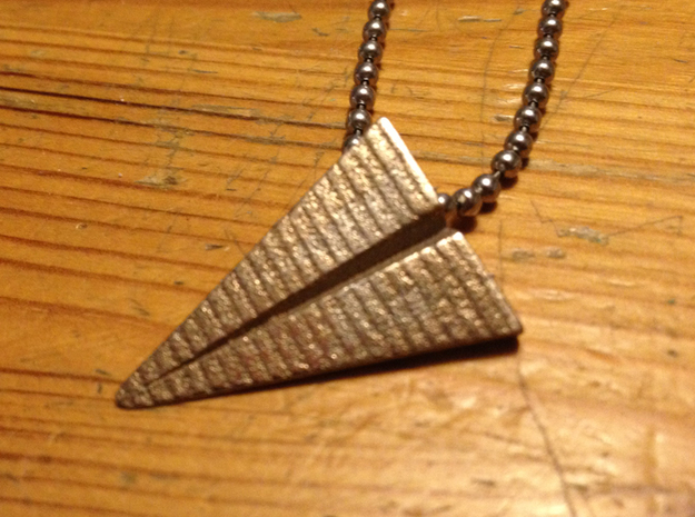 Paper plane pendant 3d printed also in stainless steel!