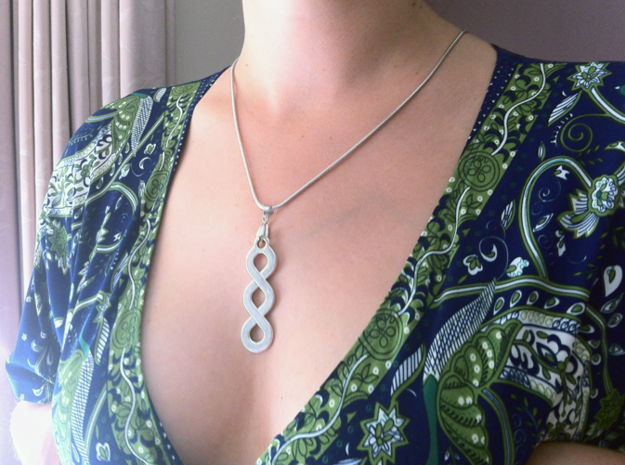 Double Infinity Pendant 3d printed Worn with the flat finish