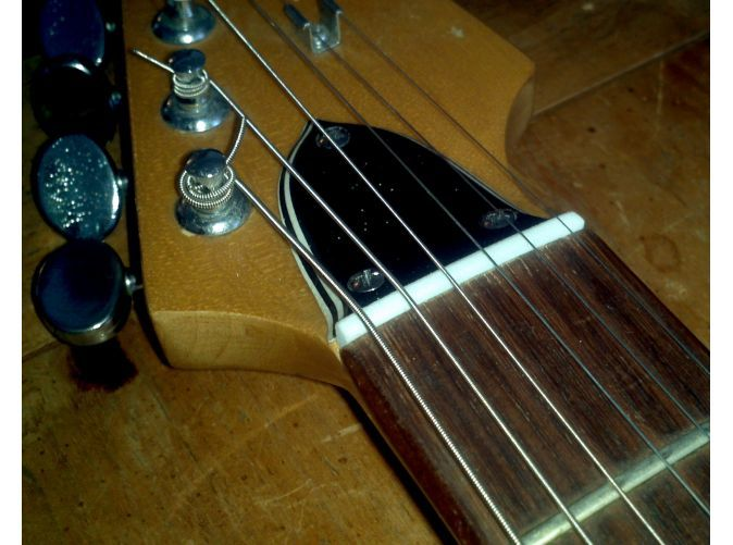 Drop-in nut installed (Note - photo shows 38mm width.  This model is wide enough to span fretboard.)