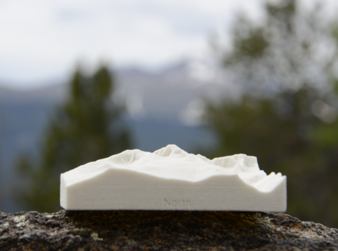 Photo of actual model in front of actual mountain, both viewed from the North.
