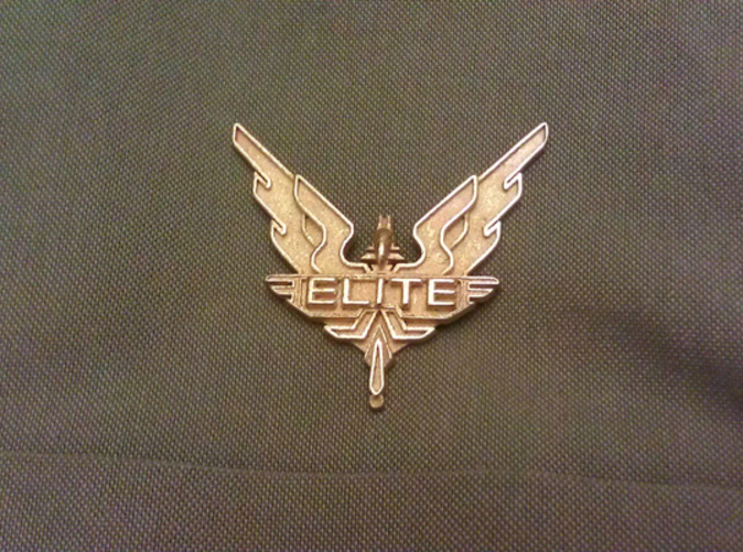 Photo showing the badge produced in Gold Plated Glossy