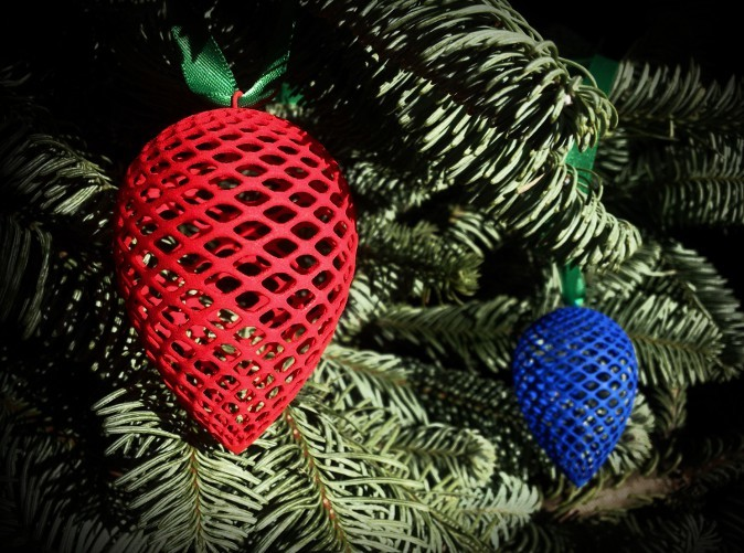 Red and Blue Pine Cones in Christmas tree