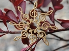 Treble Clef Snowflake Pendant in Polished Gold Steel