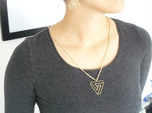 Impossible triangle pendant with a twist