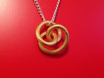 Looping Pendant in Matte Gold Steel