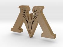 "Badge ""M"" (Exhibition) in Matte Gold Steel"