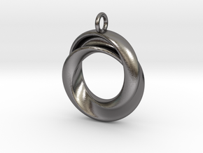 A Torus with a twist in Polished Nickel Steel
