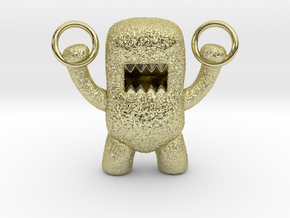 Domo Monster doing exercises with rings in 18k Gold Plated Brass