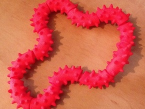 Twisting Links Fidget - Spikes in Red Strong & Flexible Polished