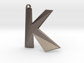 Distorted letter K in Polished Bronzed Silver Steel