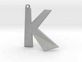 Distorted letter K in Aluminum