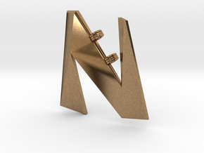 Distorted letter N in Natural Brass