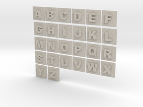 latin alphabet letters puzzle pieces in Natural Sandstone