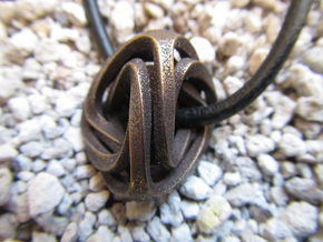 Intertwined Tetrahedra in Polished Bronze Steel