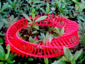 twisted torii gate loop in Red Processed Versatile Plastic