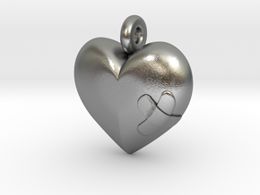 Wounded Heart Pendant in Natural Silver