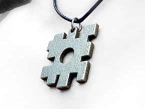 The lost puzzle piece pendant in Polished Bronzed Silver Steel
