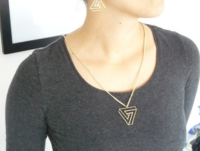Impossible triangle pendant with a twist in Polished Brass