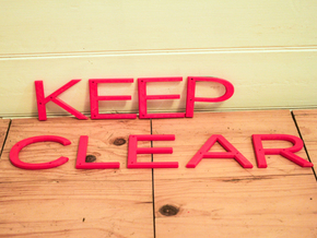Keep Clear sign in Red Processed Versatile Plastic
