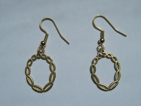 Eleven-Torus Earrings in Natural Brass