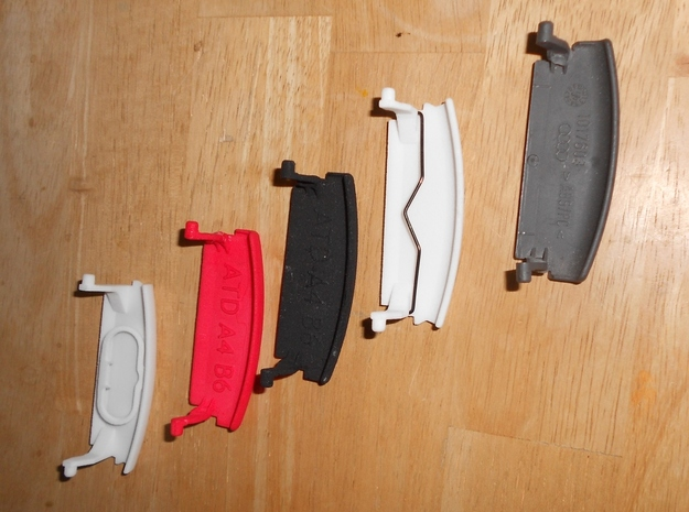 Audi A4 B6 armrest lid with spring pure/IMAGE 3d printed Overview of available parts: (left to right) part with spring replacement, red, black, with and original part
