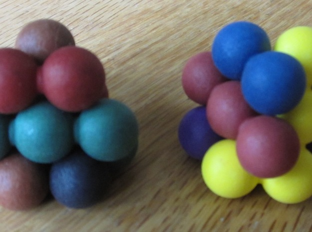 """Ell of a puzzle (spheres) 3d printed Assembly into two interlocking """"blossoms""""."""