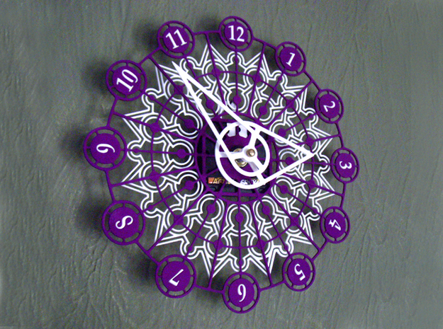 Kaleidoscope Clock - Part A 3d printed The completed Kaleidoscope Clock with Part A in Purple Strong & Flexible and Part B in White Strong & Flexible.This is a two-part clock face kit. This model is Part A. The second part is available at http://www.shapeways.com/model/580493