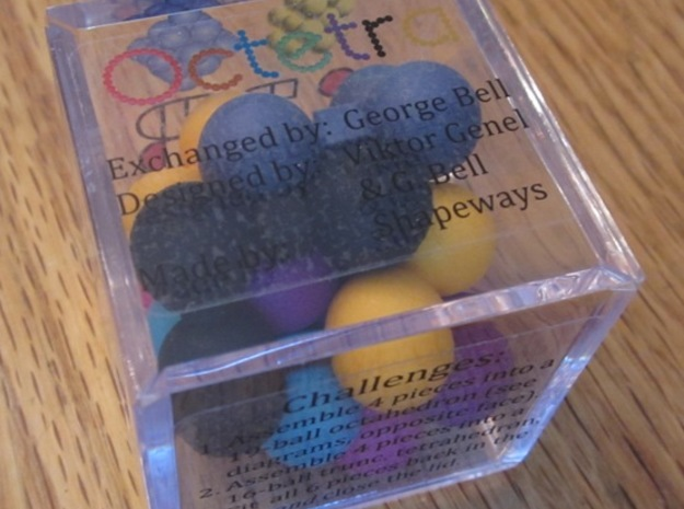 Octetra Puzzle 3d printed Packaged in a golf ball case.