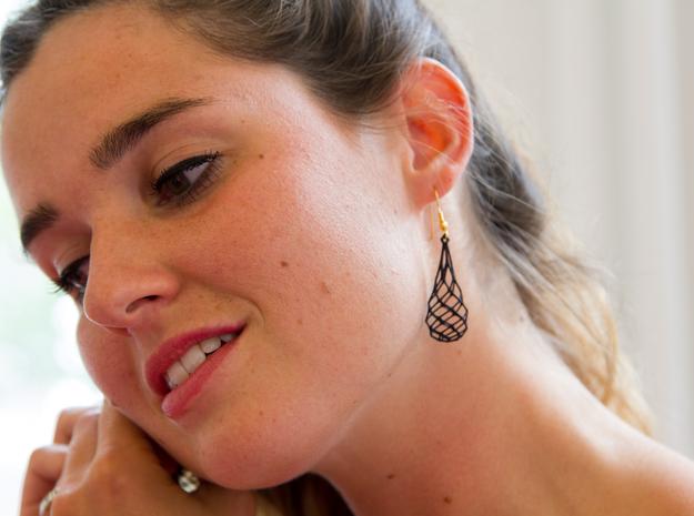 Pair of Gridlock Earrings 3d printed Laura tries on gridlock earrings from Suuz