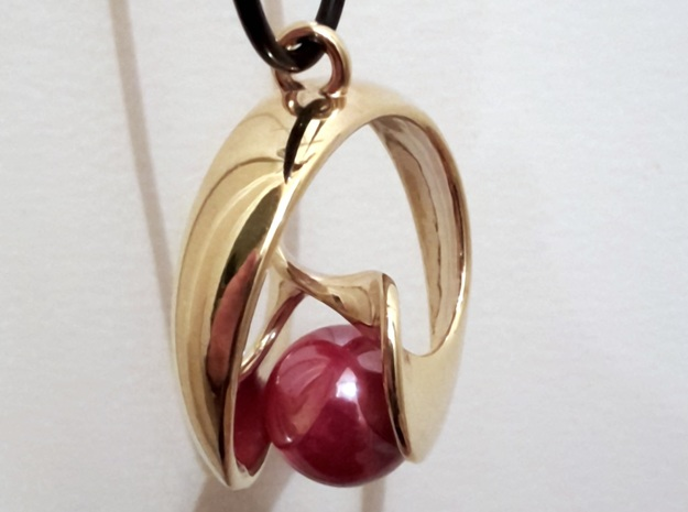 Half Mob-Tor: the half Mobius Torus Shell 3d printed in Gold Plated with a marble and a necklace (non-included)