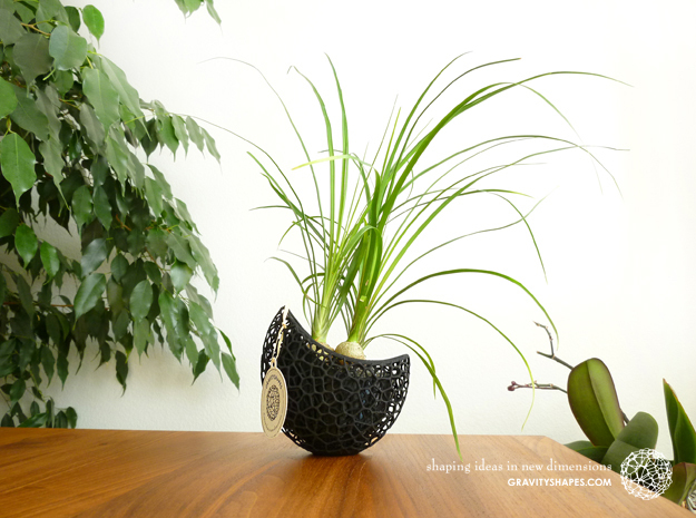 A burgeoning capsule Planter with large Pot in Black Strong & Flexible
