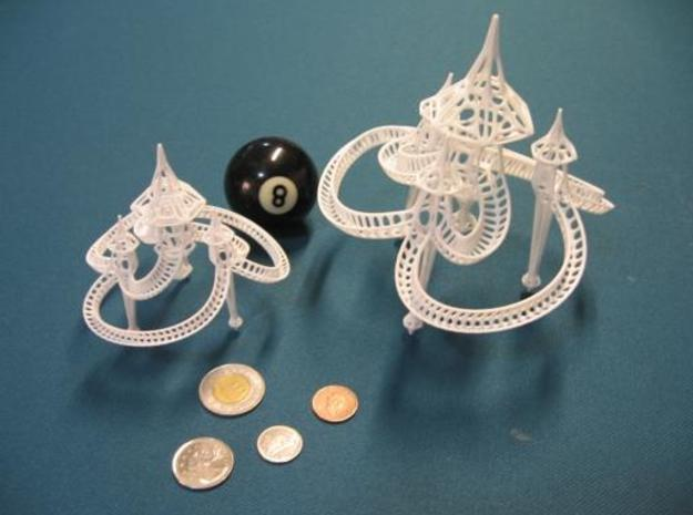 Small Sky Castle 3d printed This shows both sizes of Sky Castle in reference to pocket change and a standard 8 ball. The model that is for sale here, is the smaller one on the *left*.