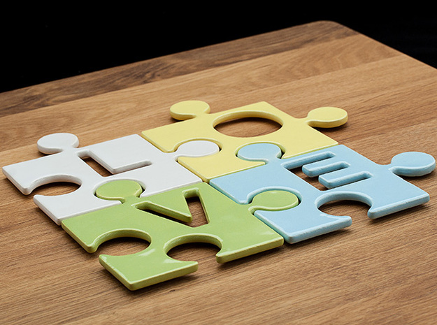 "Puzzle Piece V - ""Love-letters"" 3d printed 4 puzzle pieces combined to write the word ""love""."
