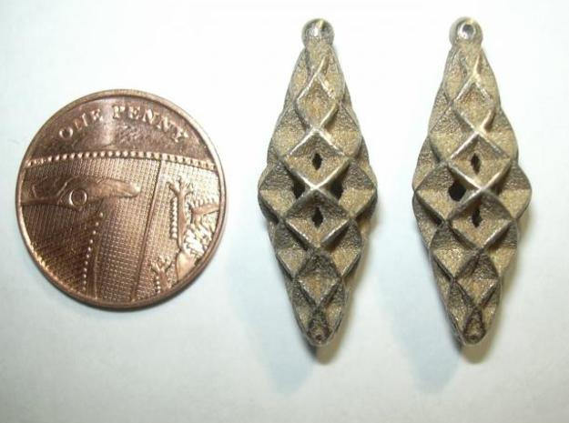 Double Spiral Star earring pair 3d printed Photo - as shipped (without penny shown for size)