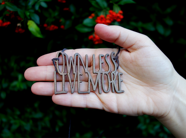 Own Less Live More in Matte Bronze Steel
