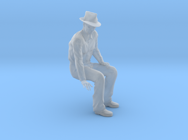 NG Fred sitting on bench wearing hat
