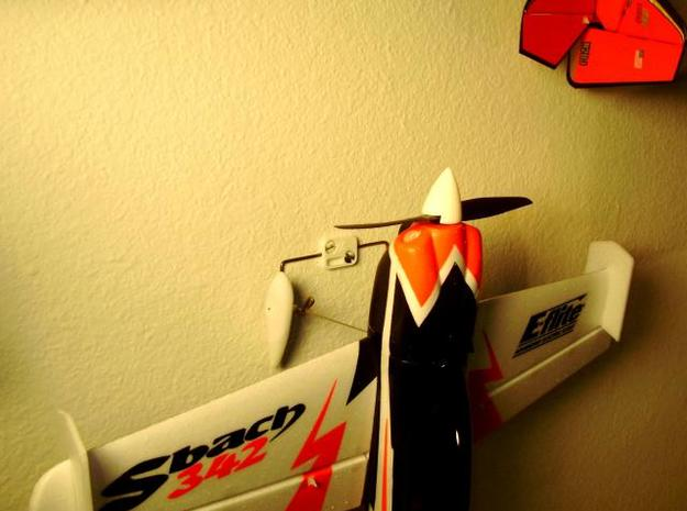 Small Plane Holder 3d printed Sbach hung from the mount on the wall.