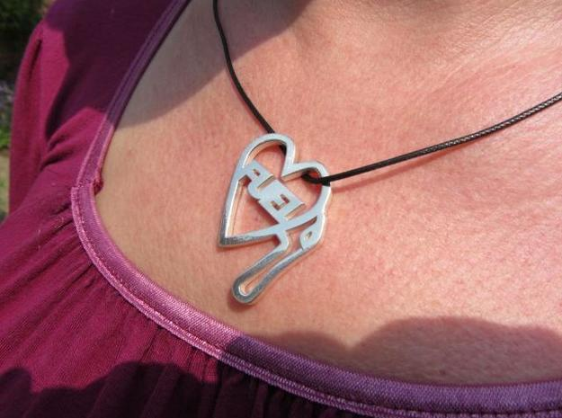 Love Pump Pendant 3d printed In silver on a simple leather cord
