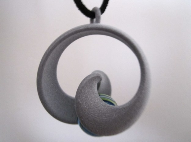 Half Mob-Tor: the half Mobius Torus Shell 3d printed in Polished Alumide (marble and necklace not included)